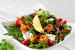 Salmon salad traditional serving on wood